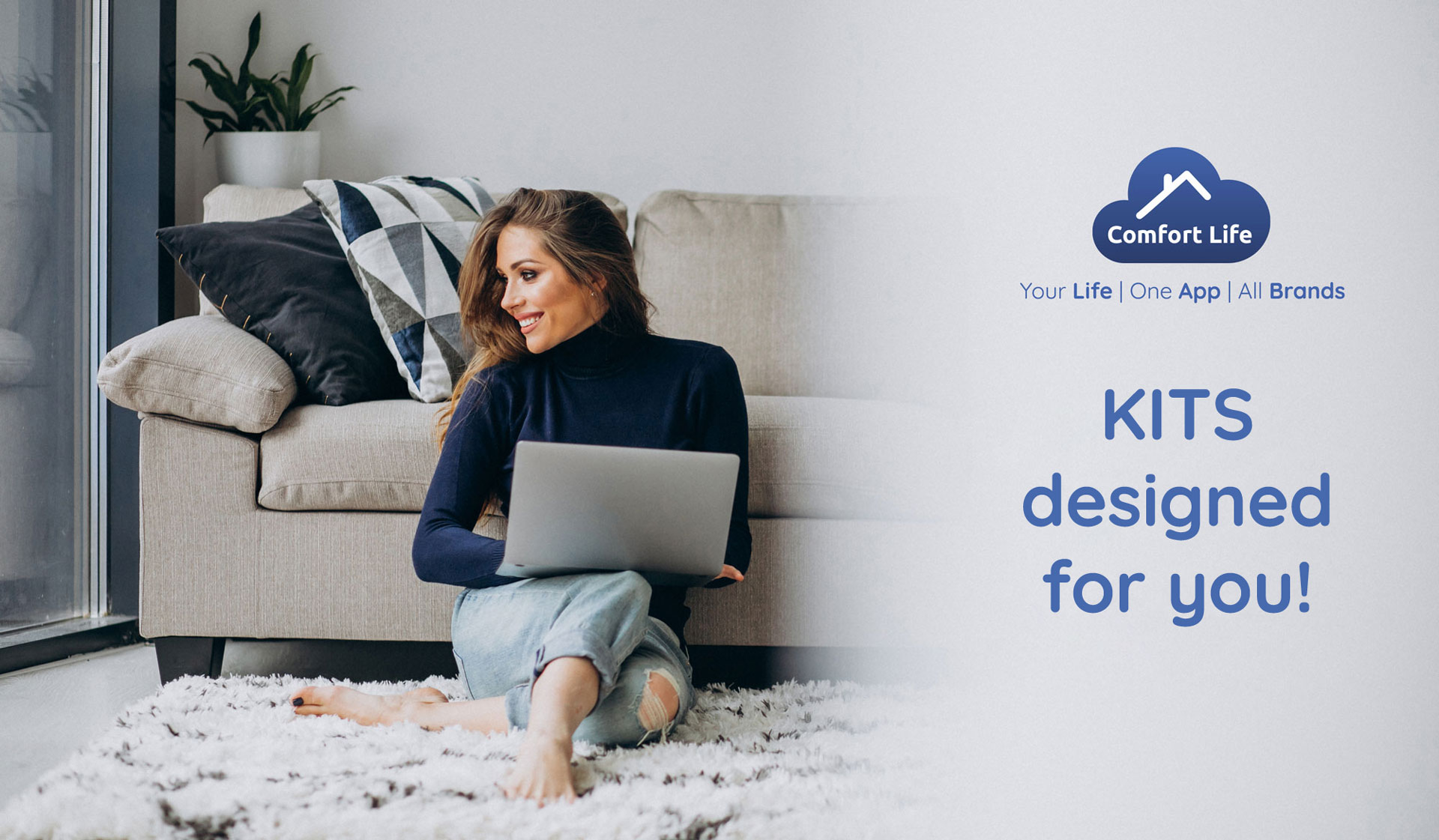 a woman sits on the floor with her laptop to represent the kits comfort life